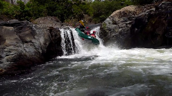 Raft over a waterfall